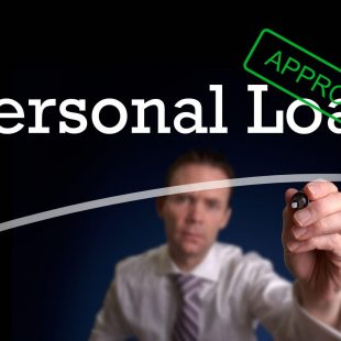 28172353 - an underwriter writing personal loan approved on a screen.